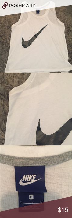Nike Tank Racer back. I do not trade. Some markings on back. (See pic) Not sure what they are from. Nike Tops Tank Tops