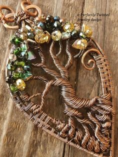 Wire Weaved Wrapped Tree of Life Pendant Necklace, Dragon Scales & Crystals, Copper Handmade Wire Wrapped Jewelry Perfectly Twisted Jewelry  This beautiful, handmade Tree of Life pendant measures 2.5 inches in height and approximately 1.5 inches wide and has been created with tiny, gorgeous Dragon Scale and Crystal beads on antiqued solid copper wires. It comes with a 18 inch copper chain. The tree of life symbol crosses all cultures and stems back to our ancient ancestors. It represents ...