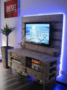 It is an amazing DIY Old pallet TV Console which is shown in this picture, you can see in the picture that beautiful blue lights are managed at the back of this console which makes it more beautiful or this is because it still looking very nice or gorgeous in the picture as we watch.