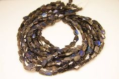 1strand  natural labradorite faceted nugget sized 10 by 14mm