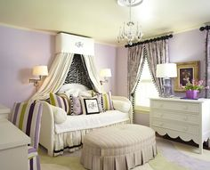 Beautiful girl's room features yellow green ceiling over lavender walls accented with cream crown ...