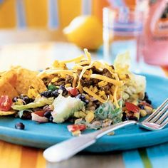 Convenience products, such as preseasoned yellow rice and picante sauce, flavor this easy one-dish meal that appeals to kids and adults...