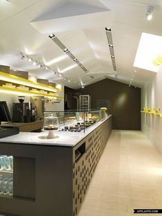 Les Bébés Cupcakery is a concept bakery shop situated in Taipei, Taiwan. Interior was designed by JC Architecture and carries out elegance, purity and simplicity. Minimalist approach with spicy yellow accents follows the concept of visual temptation.