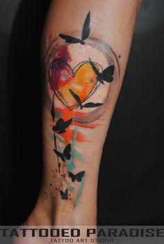 Watercolor tattoo. Love the orange