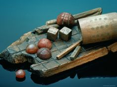sisse-brimberg-roman-iron-age-wooden-gameboard-bone-dice-and-amber-playing-pieces