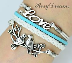 love birds sitting on the branch kissing by RosyDreams on Etsy, $2.99