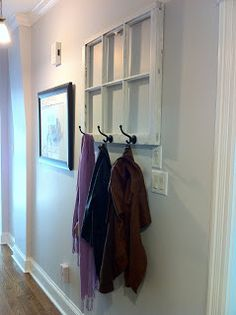 A clever way to reuse an old window frame to create a coatrack.