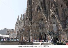 BARCELONA, SPAIN - JULY 12, 2013: The Basilica i Temple Expiatori de la Sagrada Familia - large Roman Catholic church in Barcelona, designed by Catalan architect Antonio Gaudi