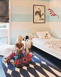 gorgeous idea for kids' rooms...love the striped wall and rug #baby #kids #interiors