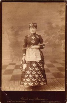 This early cabinet card depicts a woman dressed in Masonic regalia and holding her working tools.