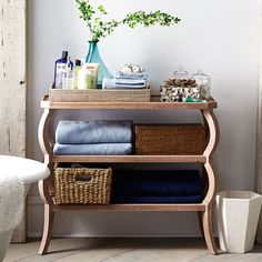"Dimensions: 36.25""w x 15""d x 30.5""h Unique piece to display items Multifunctional Great size for even a small spaceA cheer for three-tiers! For all the book or knickknacks you've wanted to display, but never had the space to do so, this tiered table's versatile design allows it to function as a great way to corral an assortment of items. Hand-carved, with a natural finish, this piece will add an organic element to any room. Display the miscellany—don't add to it!"