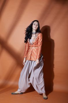 Head-Turner : Make a noteworthy entry at the festive soiree in this fusion jacket and dhoti pants from Salian by Anushree WhatsApp us now for personal shopping experience! Casual Indian Fashion, Indian Fashion Dresses, Indian Designer Outfits, Fashion Outfits, India Fashion, Pakistani Dresses, Indian Dress Up, Indian Attire, Indian Ethnic Wear