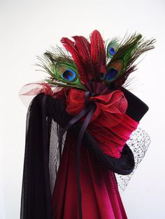 Black top hat with red velvet band, and a side piece of peacock feathers &red speckled hen feathers, side and back chiffon tulle black veil and dark red ruffle, riding straps and buttoned silk tails and finished with a full up or down bird cage face veil...stunning and made in my workshop in Scotland  https://www.etsy.com/uk/shop/Blackpin?ref=hdr_shop_menu | Shop this product here: spree.to/atvk | Shop all of our products at http://spreesy.com/JewelsByScarlett    | Pinterest selling powered…