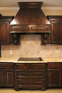 Custom Kitchen With Stainless Steel Liances Granite Countertop Tumbled Stone Backsplash Tile Stained