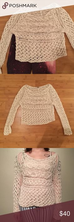 "Free People Sweater This sweater is off white color. Slightly cropped style. Worn twice and in excellent condition. Approximately 17"" across the bust when laid flat and 18"" from shoulder to hem. 77% cotton, 23% nylon Free People Sweaters"