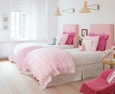 Outfitting a shared bedroom for sisters can be a challenge. The room doesn't have to feel overly frilly. Try beds dressed in white along with shades of pink, from pastel to fuchsia, for a charming and airy look