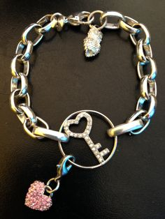 Link Locket bracelet, Key window plate, and pink crystal dangle http://www.shalenebjones.origamiowl.com/