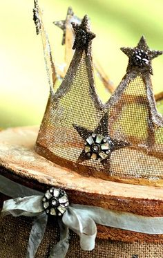 Jeweled crown from some old screen embellished with German glass glitter and faded ribbon. The crown is resting on a burlap pedestal with more faded ribbon and a vintage pin. Party Decoration, Girls Camp, Tiaras And Crowns, Lace Crowns, Crown Jewels, The Crown, Party Hats, Party Favors, Diy Party