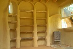 Cob built in bookcase provides extra insulation especially good for north walls. Cob Building, Green Building, Building A House, Mud House, House Built, Earthship Home, Built In Bookcase, Bookcases, Adobe House
