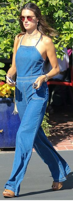 Who made Alessandra Ambrosio's white handbag and blue denim jumpsuit?