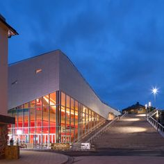 Stone bleachers climb onto the roof of this cultural centre in Molde, Norway