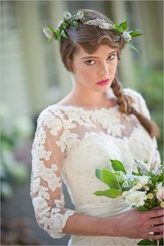 I'm kind of digging this vintage-inspired, long-sleeve lace, wedding dress...Even though this girl seems to hate life being in it.
