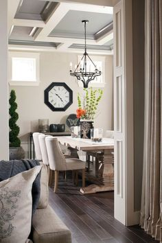 Beautiful dining room with recessed ceiling detail.