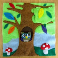Forest Scene Felt Quiet Book page with removable owl and bird in nest hiding under some leaves.  Tutorial and pattern included!?