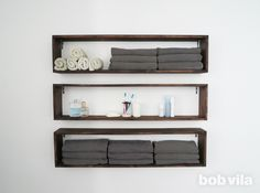Build and mount this simple set of wooden wall shelves to easily double—if not triple—the existing storage in your bathroom. Bathroom Wall Shelves, Wooden Wall Shelves, Box Shelves, Bookcase Storage, Diy Storage, Bathroom Storage, Small Bathroom, Floating Shelves, Storage Spaces
