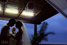 Mexico Wedding Puerto Vallarta Sunset Plaza. a tender moment of love during the ceremony.  Mexico wedding photographers Del Sol Photography