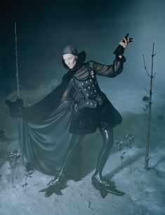 Cate Blanchett by Tim Walker for W Magazine, Nov.2015 . Cate wears : Alberta Ferretti cape, blouse (underneath), and bloomers; Alexander Wang top; Gareth Pugh collar; LaCrasia Gloves gloves; Angels Costumes ruffle cuffs; Atsuko Kudo stockings; Balenciaga brooches (on top and shoes); shoe covers from the National Theatre Costume Hire, London.
