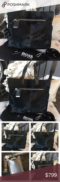 """NWOT Hugo Boss Ponyhair Travel Black Tote Bag Hugo Boss pony hair and leather large travel bag / duffel bag. It also can be unisex. Removable thick nylon crossbody shoulder strap, silver tone hardware, zipper closure, zipper front pocket, leather trim, Hugo boss engraved tassel and all around amazing! Brand new only stored. Comes with dust bag, measures approx 18"""" X 13"""".  Not sure what the retail is, but Hugo Boss bags are very expensive, I would approximate retail around $1200-$1500 minimum…"""