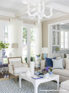 Living room color palette: blue, tan, and white.