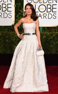 Salma is perfection in a petite package. This dress is one of my favorites because of how beautiful and elegant it is, the delicate texture of the fabric and the way that it shows her figure so beautifully. This is proof that a petite beauty can wear volume in a dress. Salma Hayek in Alexander McQueen