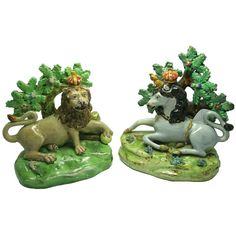 The Lion & The Unicorn by Staffordshire  England  19th century  Most rare pair of Staffordshire figures.