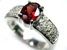 beautiful genuine garnet stone ring size 8 ra774 Garnet is associated with Honesty.This stone also brings abundance. Garnets are also used for spiritual healing. Garnet is also known as a romantic/passionate stone.