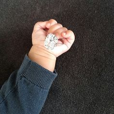 North West holding Kim Kardashian's engagement ring from Kanye West.....Lololol!...ok now thats hysterical!!!