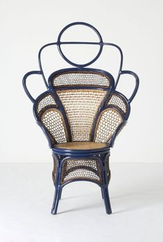 The a href=\http://www.anthropologie.com/anthro/product/26387365.jsp\Odette/a design from Anthropologie combines teak and rattan for a surreal take on the classic Thonet chair. Its available in blue or mint green for $998.