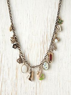 Mixed Charm Necklace- adorable charm pendants! #freepeople #necklace #jewelry