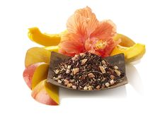 Passion Tango Herbal Tea | Bright tropical notes of papaya and mango with bright citrus lemongrass with a hint of cinnamon | Refreshing and bright, the harmonious pairing of juicy mango and papaya cascades into a tropical wonderland lush with sweet hibiscus, lemongrass, apple, and warm cinnamon. Calling forth visions of French Polynesia, one sip of this naturally caffeine-free tea leads straight to pure bliss.