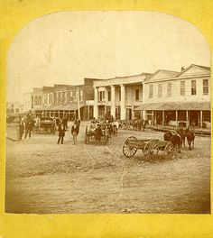 Stereoscope of the north side of the Huntsville, Texas square sometime between 1873-1875.