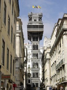 Santa Justa Life  (Elevador de Santa Justa or do Carmo), Lisbon, Portugal: The elevator connects downtown streets with the uphill Carmo Square. It was designed by Raul Mesnier de Ponsardand & is 45 meters tall.