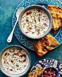 "Chilled Persian Yogurt Soup: ""Ask anyone on my staff their favorite summer dish, and they'll tell you it's this one,"" says Hoss Zaré. Filled with herbs, nuts and raisins, the soup is delicious with grilled bread. Food and Wine Magazine."