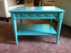 Turquoise side table with scalloped detail