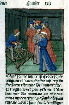 67. Torno de rueda impulsado con un palo. Hacia 1495. Petrus Comestor, JHombres mirando como trabaja un alfarero. Biblioteca Municipal de Lyon Rés Inc 58, f. 29