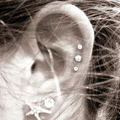 i do have lots of piercings....to have these 3 at the top and that star piercing would be pretty sick!!