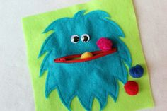 Cute and pom pom eating monster. Quick and easy busy book idea for little ones (though ? pom poms choking hazard, other options ? felt cookies)