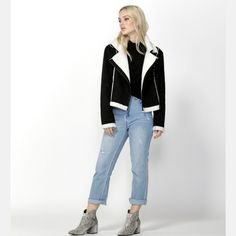 Navigator Suede Biker Jacket by SASS.  This jacket features silver hardware and has fleece lining on the lapels, hemline and around the cuffs. The hemline falls to approximately the hipline with a tailored fit. Comes in Black.  Layer this jacket over white or black jeans for a stylish everyday look. For night, dress up with a feminine blouse and a midi skirt with layered jewelry. #jacket #sherpa #fashion #alibionline Layered Jewelry, Lapels, Everyday Look, Hemline, Biker, Cuffs, Midi Skirt, Black Jeans, Dress Up