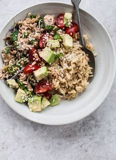 If you're looking for a quick, cheap lunch and want new ways to fancy-up canned tuna, this recipe is for you! Tuna is tossed with an orange-ginger dressing, creamy avocado and served with rice and vegetables. It's a simple yet satisfying budget recipe that makes for a great lunch.