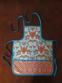Girl's apron, laminated cotton, reversible.